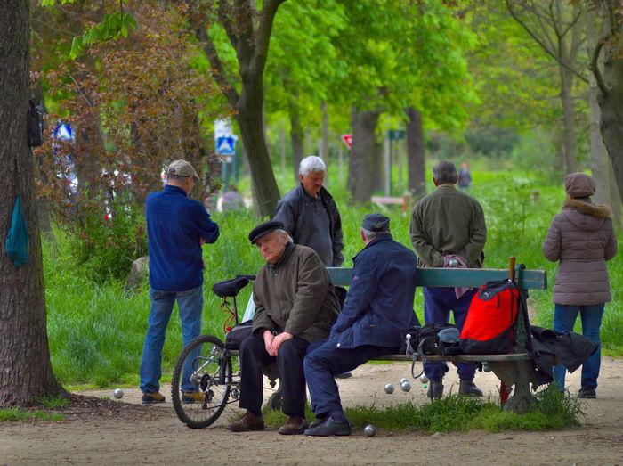 People sitting on railroad track