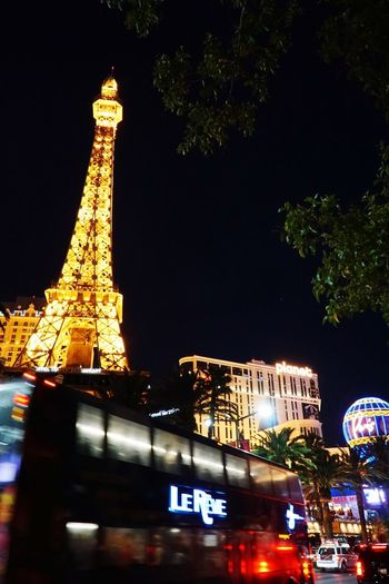 Paris Las Vegas Lasvegas Eiffel Eiffel Tower Night Architecture Built Structure Illuminated Building Exterior City Tree Travel Travel Destinations Sky Nature Plant No People Tourism Building Transportation Mode Of Transportation Tower Car Tall - High
