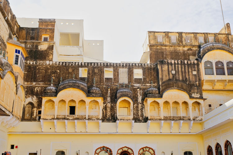 Historical building or Old Castle located in Mandawa, India. Historical Building Old Town Ancient Arch Arched Architecture Building Building Exterior Built Structure City Clear Sky Day Historical History Low Angle View Mandawa Nature No People Old Outdoors Sky The Past Travel Travel Destinations Window