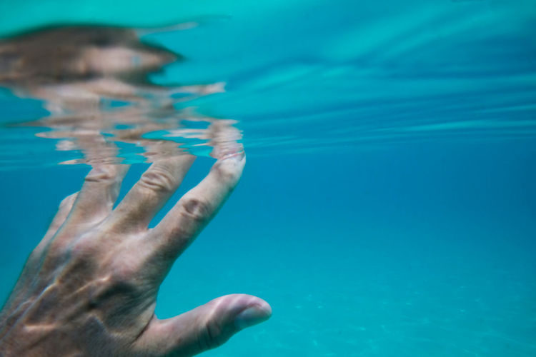 Hands Swimming Body Part Expolore Finger Fingers Hand Human Body Part Human Hand Human Limb Leisure Activity Low Section One Person Pool Purity Real People Sea Sinking Swim Swimming Swimming Pool Turquoise Colored Under The Sea UnderSea Underwater