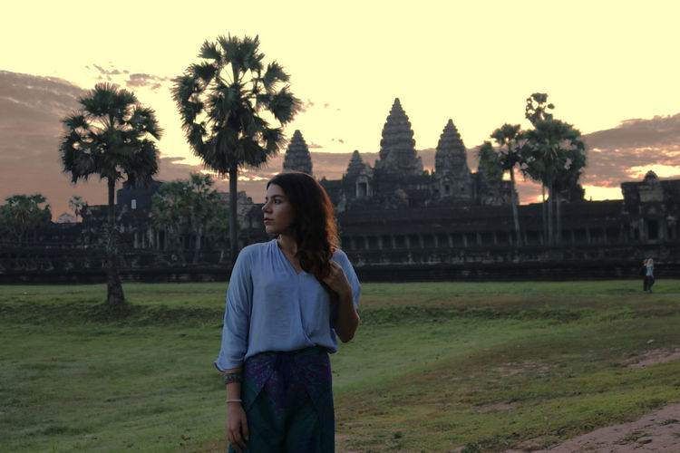 Architecture Standing One Person Tree Built Structure Young Adult Plant Real People Building Exterior Sky Young Women Three Quarter Length Sunset Lifestyles Nature Leisure Activity Casual Clothing Long Hair Hairstyle Hair Outdoors Contemplation Angkor Wat Angkor Wat, Cambodia Temple 2018 In One Photograph Moments Of Happiness International Women's Day 2019 The Art Of Street Photography Exploring Fun Springtime Decadence The Portraitist - 2019 EyeEm Awards The Traveler - 2019 EyeEm Awards The Great Outdoors - 2019 EyeEm Awards