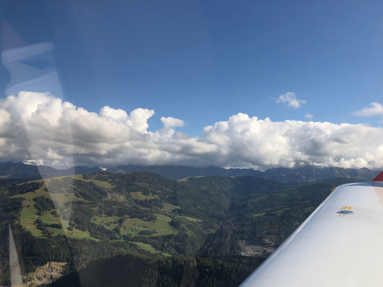 airplane, sky, cloud - sky, air vehicle, mode of transportation, transportation, flying, beauty in nature, travel, scenics - nature, nature, no people, environment, mountain, landscape, journey, aircraft wing, mid-air, aerial view, day, outdoors