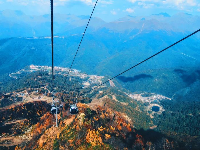 High angle view of overhead cable cars over mountains