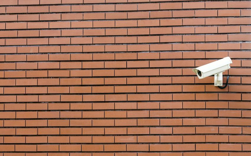 Security Camera Against Brick Wall