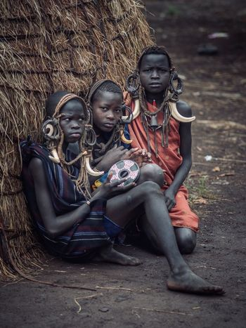 Mursi Ethiopia Childhood Child Sitting Girls Females Full Length Boys Togetherness Family Women Day Casual Clothing People Men Offspring Happiness Outdoors Sister A New Beginning