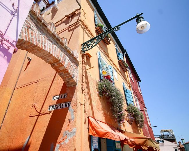 Vintage Orange Italy Buranoisland Burano Architecture Built Structure Building Exterior Low Angle View Building Sky Nature Outdoors Sunlight Hanging Lighting Equipment
