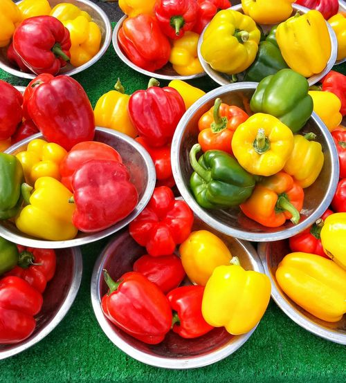 High angle view of bell peppers in container at market stall