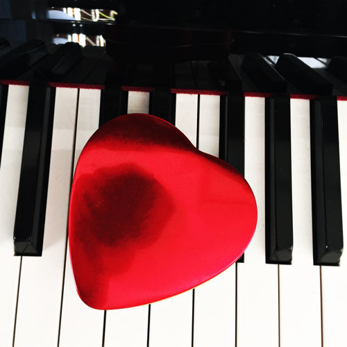Love heart on a piano Piano Love Music Keys Red Keyboard Musician Jazz Love Song Song Composition Still Life Greetings Shape Postcard Card Musical Classic Concert Education Music School Romantic Romance Wedding Friendship