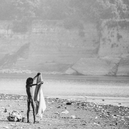 Sadhu standing on riverbank