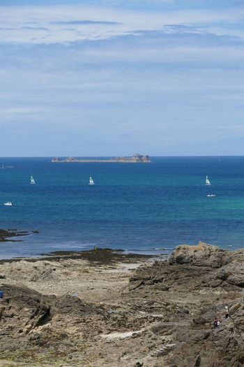 Sea Horizon Over Water Rocks And Water Shoreline Beach Tidesout Seascape Photography Seascapes St Malo Brittany France Beachphotography Beach Photography Rocky Beach Sailing Boat