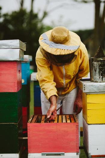 Beekeeper working outdoors
