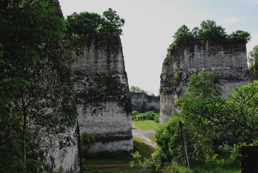 Ancient Civilization Bali Bali, Indonesia Beauty In Nature Cultures Day Garuda Wisnu Kencana Grass Green Color Growth History INDONESIA Landscape Nature No People Outdoors Rocks Scenics Sky Travel Destinations Tree Tree Area