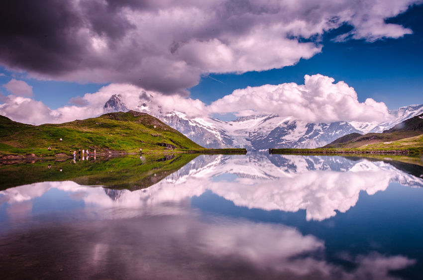 The dark clouds spreading its arms, crystal clear lake in the front, a tourist stoning to ripple the pool and yet it stands mighty - the swiss alps. Lake Bachaplsee, a beauty of alps. Alps Anpaphotography AravindNarayanan Bachalpsee Beauty In Nature Grindelwald Lake Landscape Mountain Range No People Reflection Swiss Alps Swiss Mountains Switzerland Switzerland Alps Tranquil Scene Travel Destinations