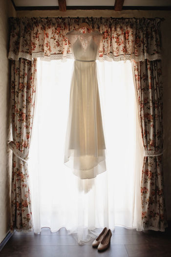 Clothes hanging on window at home