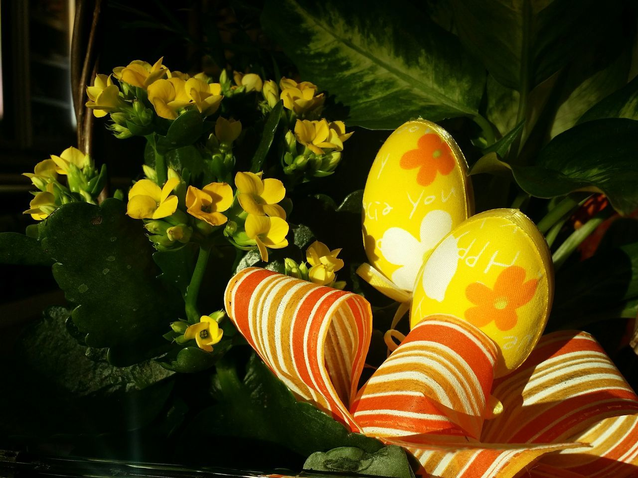Close-Up Of Easter Eggs And Flowers