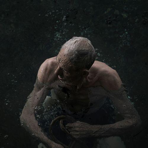 High Angle View Of Shirtless Man Swimming In Lake