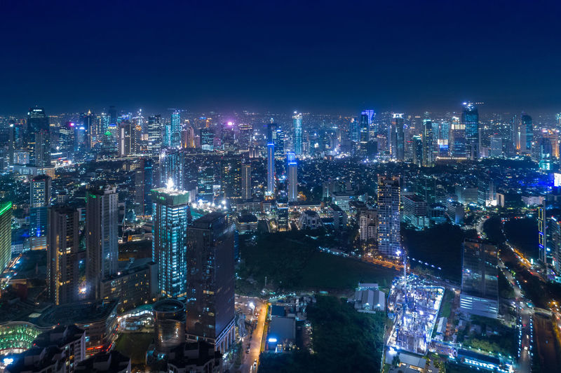 Aerial Night City View of Metropolis City Jakarta Indonesia at Blue Hour Building Exterior City Architecture Built Structure Cityscape Night Building Illuminated Office Building Exterior Skyscraper Urban Skyline Modern Landscape City Life Tower No People Residential District Sky Tall - High Financial District  Outdoors Aerial View INDONESIA Jakarta