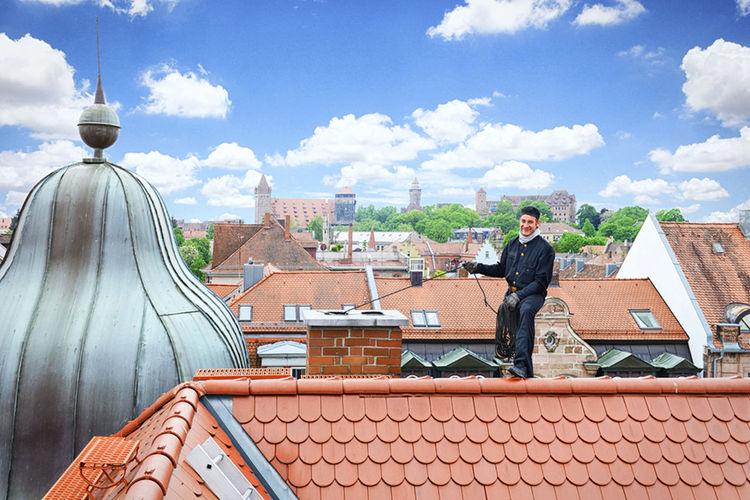 Man standing on cobblestone street against sky