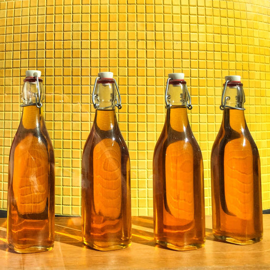 Four Bottles Full Of Orange Liquid Gdynia 19 September 2015 Iphone 6 Plus IPhoneography EyeEm Masterclass EyeEm Best Shots Colors Orange Yellow Still Life Bottle Gdynia IPS2016Stilllife IPS2016StillLiife