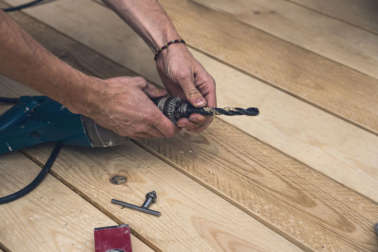 High angle view of man working on wooden table