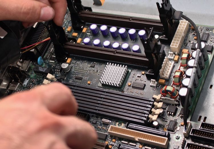 Cropped hands repairing computer mother board