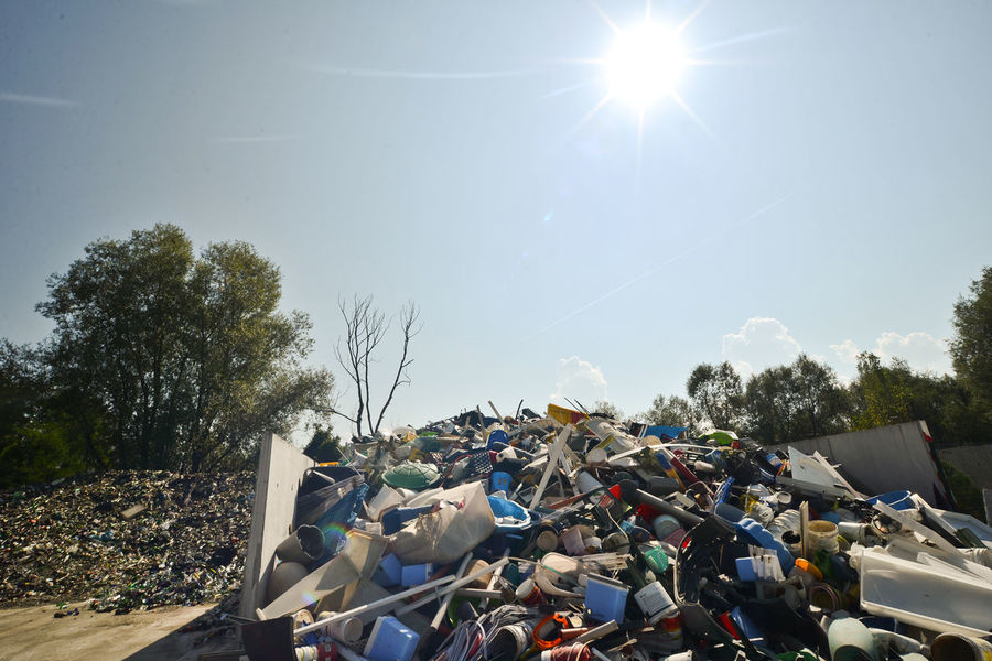 This photography was taken for Ice age mission, and it shows pollution of our Earth. Abundance Color Palette Colorful Colors Colour Of Life Day Dumplings Dumpster Environmental Issues Garbage Garbage Bin Garbage Can Garbage Dump Heap Ice Age Large Group Of Objects Recycling Retail  Roadside Stack Sun Sunlight Sunny Tradition Tree