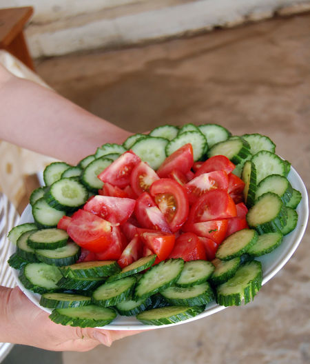 cucumber and tomato salad Cucumber Hands Homemade Housewife Salad Show Close-up Day Food Food And Drink Fresh Freshness Healthy Eating Healthy Lifestyle High Angle View Holding Housevife Human Body Part Human Hand One Person People Real People Tomato Vegetable