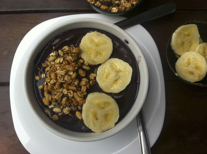 Acai bowl with granola and banana Acai Bowl Açai Bowl Breakfast Food Food And Drink Freshness Healthy Eating High Angle View Ready-to-eat Serving Size Superfood