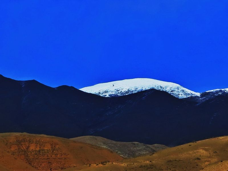 Blue Sky Black Mountain No People Blue Nature Beauty In Nature Outdoors Snow In The Mountains Landscape Mountain