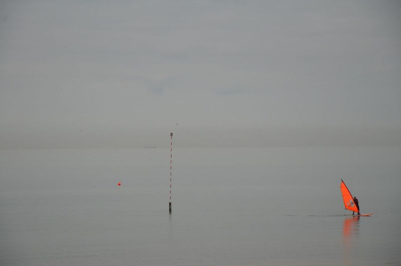 Orange windsurfer Seascape Grey Sea Windsurfing Whistable Water Transportation Waterfront Outdoors Cloud - Sky