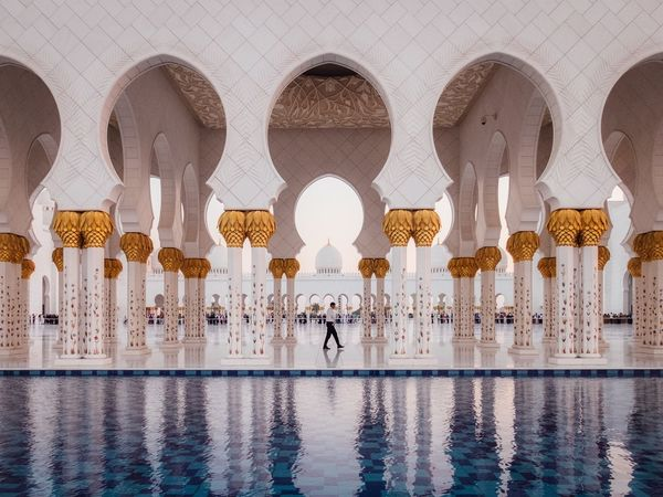 The Architect - 2017 EyeEm Awards Arch Architecture Reflection Water Religion Architectural Column Built Structure Architectural Feature Swimming Pool Spirituality Travel Destinations Tile Reflecting Pool Day Place Of Worship People Outdoors One Person City Adults Only Streetphotography The Street Photographer - 2017 EyeEm Awards Abu Dhabi Symmetry