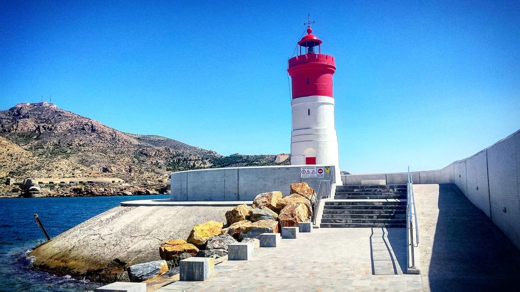 En Navidad... su nombre Protection Safety Lighthouse Outdoors Blue Sea Day Sunlight Guidance Beach No People Clear Sky Water Sky Nature Building Exterior Architecture Cartagena Cartagenaspain Cartagena,Murcia Cartagena, Spain Cartagena Spain Puertodecartagena Puerto De Cartagena