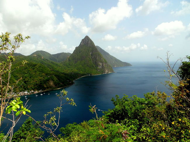 This picture is of the the Gros Piton in Soufriere, St.lucia. Beauty In Nature Caribbean Cliff Nature's Diversities Distant Hill Landscape Mountain Mountain Range Mountain View Mountains Nature Ocean Ocean View Outdoors Rock Rock Formation Scenics Seeing The Sights Tranquil Scene Tranquility Tropical Climate Vacation Voyage Water
