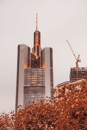Commerzbank Tower Building Exterior Built Structure Architecture Sky Building Nature City Autumn Plant Office Building Exterior Tower No People Tall - High Change Low Angle View Industry Day Machinery Tree Clear Sky Outdoors Skyscraper Frankfurt Tower Commerzbank Tower