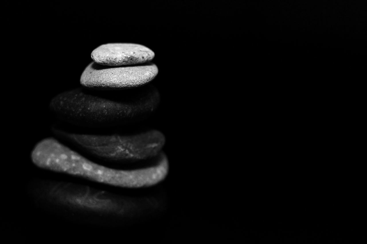 stack, still life, balance, copy space, black background, no people, studio shot, pebble, close-up, indoors, freshness