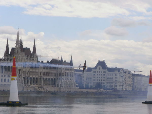Red Bull Air Race over the Danube, with the Parliament building in the background, in Budapest, Hungary. Airplane Budapest Built Structure Competition Danube Danube In Budapest Hungary International Landmark MyCity❤️ Outdoors Parliament Building Red Bull Air Race Showcase July Tourist Destination Waterfront Red Bull Air Show