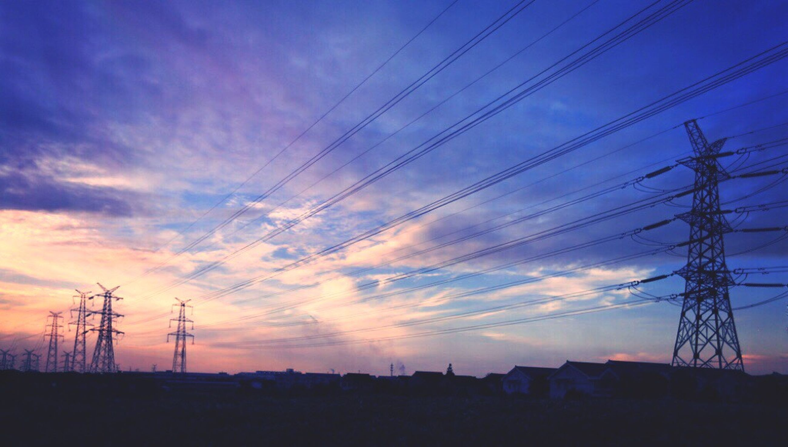 power line, electricity pylon, power supply, electricity, fuel and power generation, cable, sunset, connection, sky, low angle view, power cable, cloud - sky, cloud, no people, outdoors, nature, beauty in nature, scenics, tranquility, cloudy, tranquil scene, blue, landscape, dark