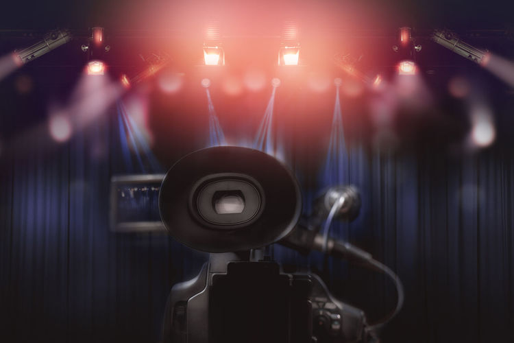 Close-Up Of Television Camera Against Illuminated Stage