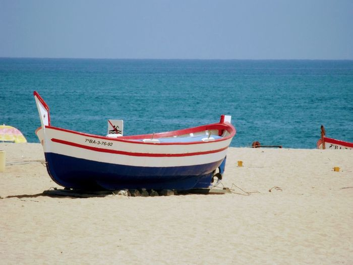 Sea Beach Sand Horizon Over Water Shore Water Nautical Vessel Nature Scenics Beauty In Nature Boat Tranquil Scene Tranquility Transportation Day Mode Of Transport Outdoors Sky Clear Sky No People Spain, Calella Costa Brava