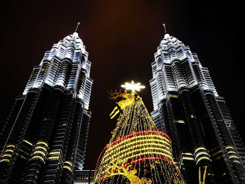 Night Illuminated Architecture Celebration Modern Low Angle View Travel Destinations Christmas Skyscraper Building Exterior Christmas Lights City Built Structure Christmas Decoration Holiday - Event No People Christmas Market Outdoors Sky Cityscape