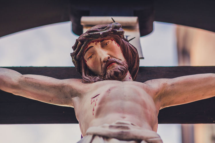 Low angle view of jesus christ crucified statue