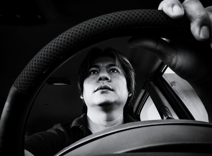 Low angle view of man driving car