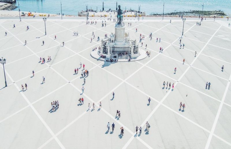 High angle view of people near statue at praca do comercio