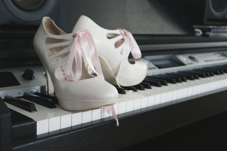 High heel shoes on top of a piano Fashion Fashion Photography Wedding Wedding Photography Wedding Day High Heels Heels Wedding Heels Shoes Shoe Shoes ♥ Shoeselfie Shoes Of The Day Love Save The Date White White Color White Shoes Black Backgrounds Background Style Trend Women Woman Clothing Cloth Clothes Piano Grand Piano
