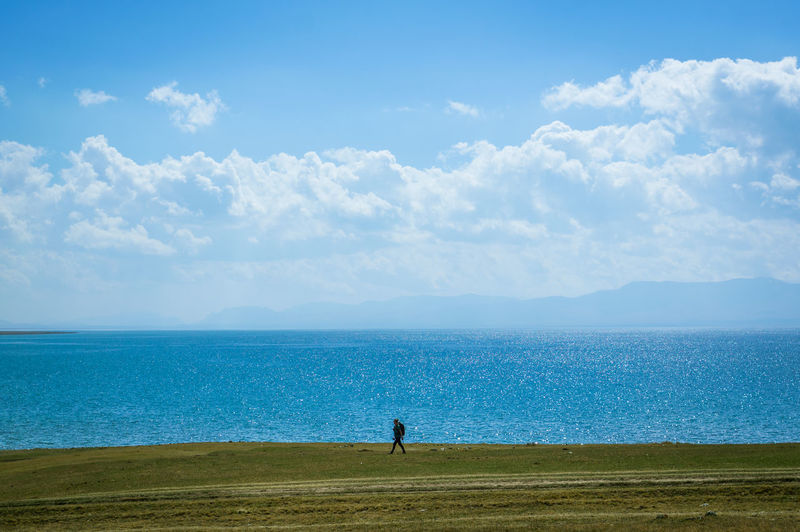 Beauty In Nature Blue Cloud - Sky Day Hiking Horizon Over Water Independant Tra Independent  Men Nature One Person Outdoors People Real People Scenics Sea Sky Solo Travel Standing Tranquil Scene Tranquility Traveler Water Sommergefühle