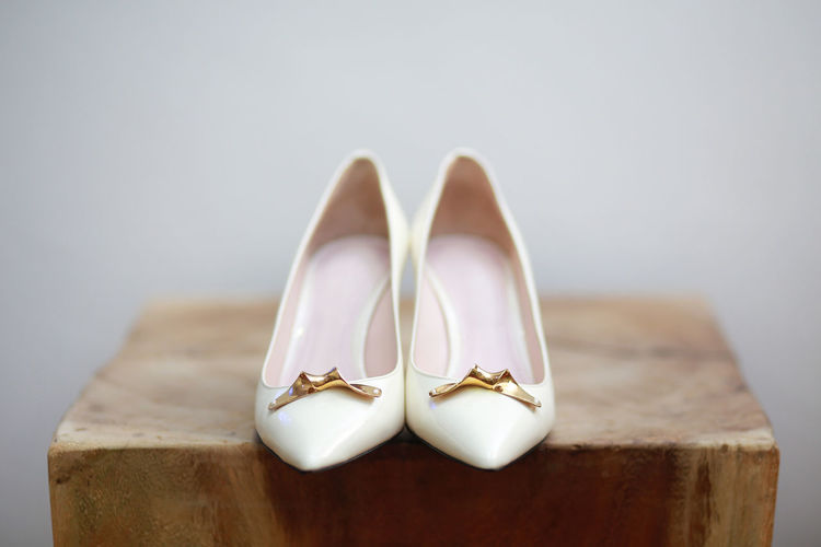 White shoes for bride on wooden block Pair Close-up Shoe Still Life Indoors  Two Objects Positive Emotion Event Celebration Love No People Wealth Selective Focus Wedding Luxury Elégance Ring Life Events Personal Accessory High Heels Female Fashion Bride Bridal Shoes White Elegant