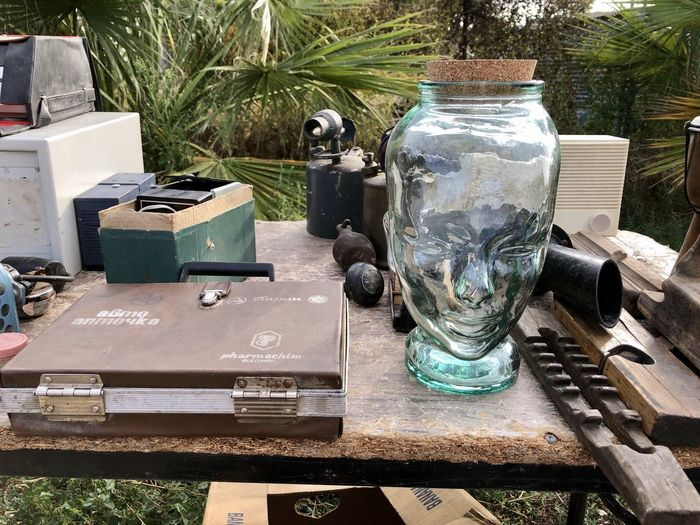 Close-up of old objects on table in yard
