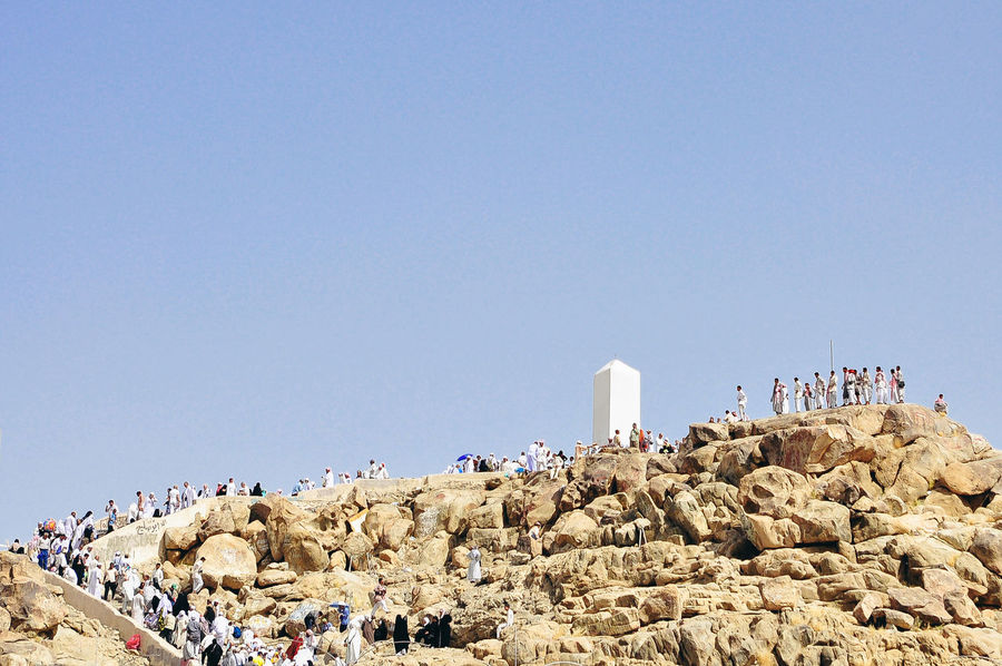 Muslims around the world visiting Jabal Rahmah for prayers Arab Blue Clear Sky Day Hajj Hill History Jabalrahmah Lifestyles Low Angle View Makkah Mecca Nature Outdoors Prophet Sky Travel Destinations Umrah