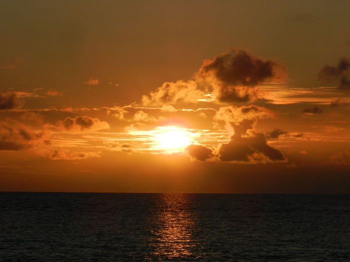Amber Radiance Beauty In Nature Cloud - Sky Horizon Over Water Idyllic Nature Orange Color Outdoors Rippled Scenics Sea Seascape Sky Sun Sunset Tranquil Scene Tranquility