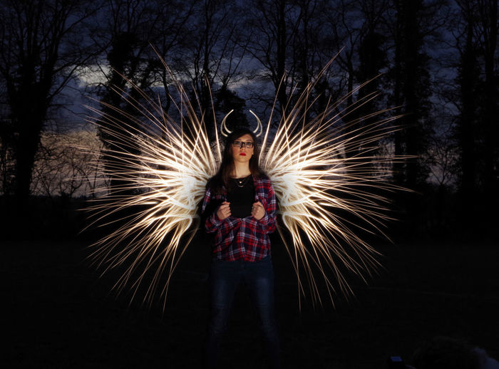 Light Art Supernatural Adult Beautiful Woman Blurred Motion Celebration Firework - Man Made Object Firework Display Front View Full Length Illuminated Long Exposure Motion Night One Person Outdoors People Real People Sparkler Standing Tree Young Adult The Week On EyeEm EyeEmNewHere